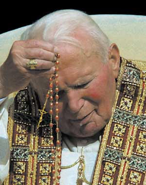 Pope John Paul II Praying the Rosary