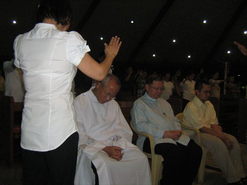 Woman Praying for Priests